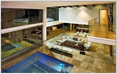 Luxurious swimming pool incorporated into the living room! Follow us on Facebook!  CLICK HEREVisit Pricey Pads