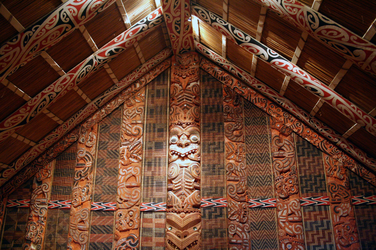 Interior of the wharenui, the Maori meeting house, Auckland Museum, New Zealand.