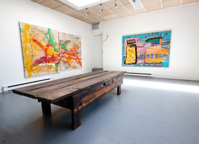 M> PM Elyse George Gallery - Toronto 100 yr old work bench surrounded by Basquiat-inspired work of Canadian artist, Scotty Schafer