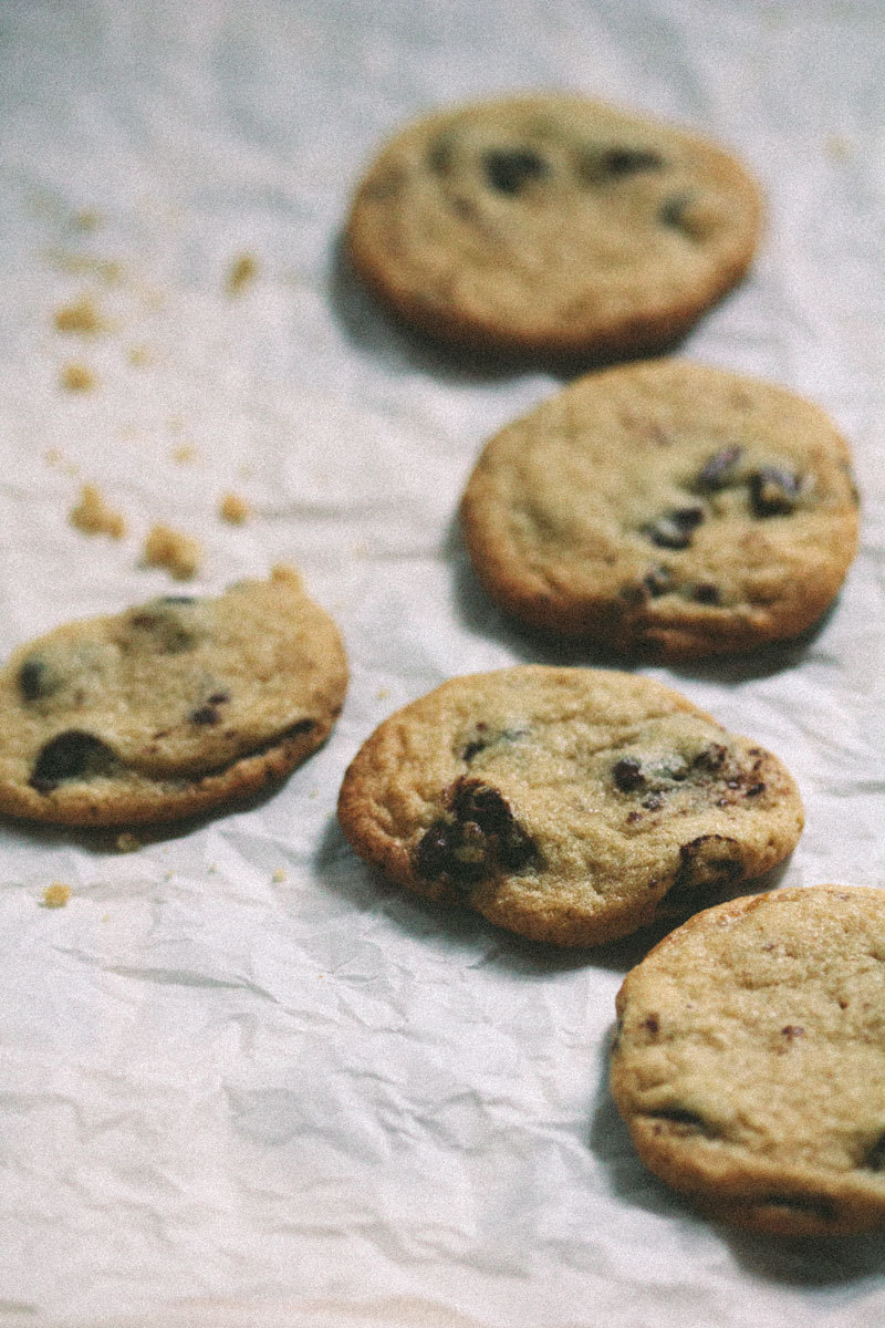 "Mark Bittman's Cookies The first eight months I lived in New York City I shared a small apartment with two other women I didn't know. The kitchen was the smallest I'd ever used. We had a fridge, a microwave, and a stove. We did own an oven, too, but it had stopped working for some reason or another and no one cared enough to deal with getting a new one. It was most likely an unlit burner in the back. Simple. We still did nothing. I discovered our oven predicament one weekend when I tried baking a pizza that then took an hour to cook. That sort of tipped me off on that one. One of my roommates tried getting creative and ""baking"" on the stovetop, generally just ending in a fiasco. I stopped using ovens after that, even after I'd left the apartment for one with working-condition appliances. I suppose when you can't use something you learn not to use it at all. It's been almost two years since I moved into that first apartment and this is the first batch of homemade cookies I've made since. Pulling them out of the oven, I felt a sudden urge of pride, like I'd conquered the beastly wild and lived to tell.Recipe: Chocolate chip cookies from Mark Bittman's How to Cook Everything."
