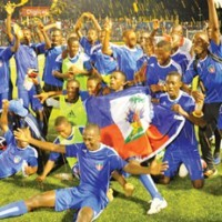 """At the Sylvio Cator stadium PAP, the under-17 Haitian National Soccer team defeated the Dominican Republic to lead the group of St Lucia, D.R., Curacao with 9 out of 9 points.  Jean Wisner Dérival scored a goal in the first half and another by Philippe Terson came in the second half (67th minute) and with only one goal form the Dominicans, Haiti closed out the group qualify for the second round of the Caribbean competitions in preparation for the U-17 World Cup that will be held in the United Arab Emirites in 2013.  Haitians took control of the game, particularly after the break, led by a very aggressive midfield attacking game.  Dominicans scored in the 79th minute through their best player, Quesada, who had a free kick."""