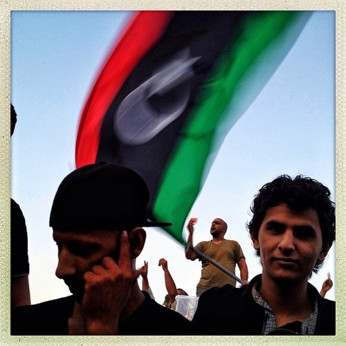 "Capturing Libya: Through a Hipstamatic Lens To photojournalism purists, it was pure blasphemy: a prestigious prize, third place for photo of the year, granted to a New York Times photographer who'd used not a 35mm to document U.S. soldiers in Iraq, but simply, his iPhone — and an app called Hipstamatic. Immediately, traditionalists went berserk: ""What we knew as photojournalism at its purest form is over,"" one photojournalist lamented. Using Hipstamatic in a news report, another commentator proclaimed, was ""cheating us all."" And yet, to Ben Lowy, a conflict photographer who has made a career out of a certain brand of iPhonography — and will debut the first ever photojournalism-inspired Hipstamatic lens with his namesake later this year — the award was a well-needed wake-up call for photo fundamentalists. Last February, Lowy set out to capture the uprising in Libya from his iPhone, alongside millions of protesters who'd document the Arab Spring on their mobile devices. In October, Lowy's Hipstamatic images of everyday life in wartime Kabul were published in the New York Times Magazine, prompting the magazine's photo editor, Kathy Ryan, to defend their use on the paper's 6th Floor blog. And since then, Lowy has published an iPhone photo a day — from dramatic images of war to mundane life in Brooklyn — on his Tumblr, captured under the title, iSee.  Lowy sees the rise of the iPhone photo not so much as an assault on journalism, but as an asset, freeing a photographer from heavy machinery, enabling greater intimacy with a subject, and making candid snapshots easy. This month, Lowy is back in Libya, documenting the country's growing pains in the aftermath of Gaddafi's overthrow and the country's first democratic election in 60 years. On a grant from the Magnum Foundation's Emergency Fund, Lowy's got three 35mm cameras with him, but he hasn't used them. Instead he's capturing it all via the Hipstamatic Lowy lens, which uses a bit of contrast and desaturation (but minimal processing) to convey its images. For the next week, Storyboard will publish exclusive images from Lowy from his time in Libya. We spoke with him about what makes iPhonography different. What can you capture on an iPhone that you can't on a regular camera? The tool itself is a lot smaller and inconspicuous and can be a bit more subtle. I think it engenders a greater sense of intimacy with subjects because you're not putting a big camera in their face. Is it part of your duty as a photojournalist to embrace new mediums? I think the responsibility of a photographer is not just to communicate something, but to find a way to communicate it more efficiently. Just as a writer would vary prose, photographers change aesthetic. Is there a reason you've decided to use your iPhone in Libya specifically?  The reason is twofold: One, I want to show images that will grab the audience, because they look like the kind of images that anybody can shoot. Everybody takes pictures of their dogs with an iPhone these days; that just speaks to the democratization of the tools. But I think there's something more intimate about an iPhone picture because of that, so maybe people will look more closely at it. I also think that using the iPhone is apropos for the Arab Spring because so much of the content that began the Arab Spring was from mobile technology. Do you think you get better access with an iPhone? I think in the past maybe, but I think now people are very aware that the iPhone is a camera. But it is easier in certain places, like on the subway, where you have to make eye contact. Photographing in a warzone is not hard, because people want you there to document what's happening. But when I teach students, I tell them to stay on a subway for a day in one car, to take pictures of people with a camera, then put the camera down and make eye contact with the person you just photographed. That's scary as hell. How does an iPhone benefit you in a warzone? I mean, there's less to carry around, and it's very quick. But it's just a different ballgame. It seems like iPhone photos have become so ubiquitous that you'd have to be an absolute dinosaur not to embrace them. Is there still any real debate about their journalistic validity? There are still purists who hold onto that idea that the iPhone is not still a real camera, or doesn't make a real image, and quite frankly, I think those arguments are bullshit. It's the same argument that people made when color film was invented, or that painters made when photography was invented. People don't like change, and they don't like to adapt. There's nothing real about black and white film photography that is any more or less real than me taking a picture on my iPhone. — Jessica Bennett, formerly of Newsweek, is the executive editor of Tumblr All photos by Benjamin Lowy/Getty Reportage."