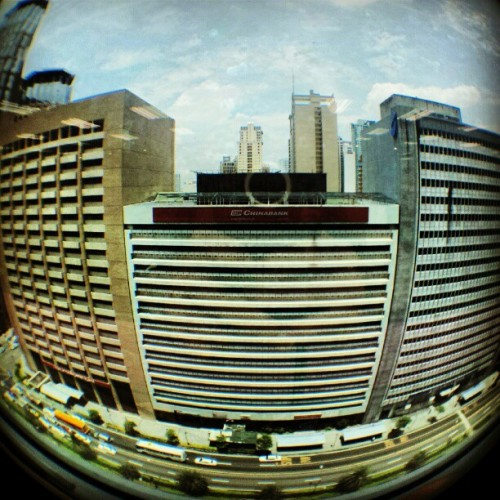 Test shot. #Photojojo #fisheye #cityscape #city #building #street #streetphotography #buildings #window  (Taken with Instagram at Robinsons Summit Center)