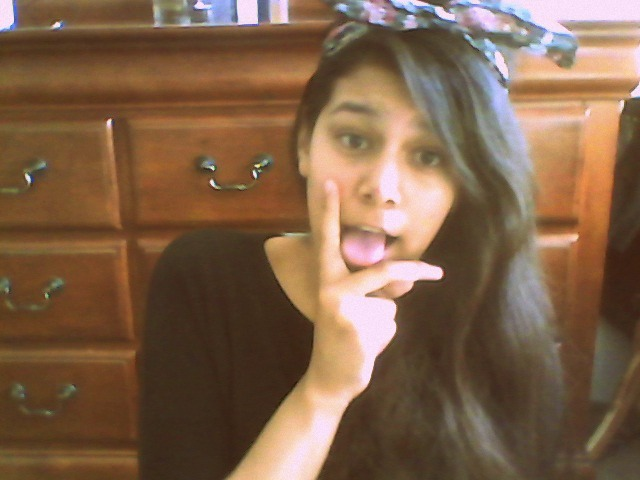 me being stereotypical with a bow thingy in my hair.