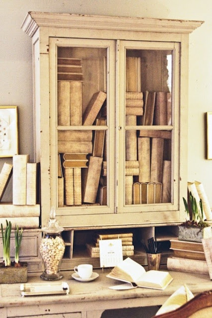 shabby chic bookcase and desk. the books are messy but all the same color, so the result is sweet to the eye.