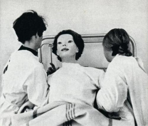 "In June of 1972, a woman appeared in Cedar Senai hospital in nothing but a white gown covered in blood. Now this in itself should not be too surprising as people often have accidents nearby and come to the nearest hospital for medical attention. But there were two things that caused people who saw her to vomit and flee in terror.The first, being that she wasn't exactly human. she resembled something close to a mannequin, but had the dexterity and fluidity of a normal human being. her face, was as flawless as a mannequins, devoid of eyebrows and smeared in make-up.She had a kitten clenched in between her teeth, her jaws clamped so unnaturally tightly around it to the point where no teeth could be seen, the blood was still squirting out over her gown and onto the floor. She then pulled it out of her mouth, tossed it aside and collapsed.From the moment she stepped through the entrance to when she was taken to a hospital room and cleaned up before being prepped for sedation, she was completely calm, expressionless and motionless. The doctors had thought it best to restrain her until the authorities could arrive and she did not protest. They were unable to get any kind of response from her and most staff members felt too uncomfortable to look directly at her for more than a few seconds.But the second the staff tried to sedate her, she fought back with extreme force. Two members of staff holding her down as her body rose up on the bed with that same, blank expression.She turned her emotionless eyes towards the male doctor and did something unusual. She smiled.As she did, the female doctor screamed and let go out of shock. In the womans mouth were not human teeth, but long, sharp spikes. Too long for her mouth to close fully without causing any damage…The male doctor stared back at her for a moment before asking ""What in the hell are you?""She cracked her neck down to her shoulder to observe him, still smiling.There was a long pause, the security had been alerted and could be heard coming down the hallway.As he heard them, she darted forward, sinking her teeth into the front of his throat, ripping out his jugular & letting him fall to the floor, gasping for air as he choked on his own blood.She stood up and leaned over him, her face coming dangerously close to his as the life faded from his eyes.She leaned closer and whispered in his ear.""I…am….God….""The doctors eyes filled with fear as he watched her calmly walk away to greet the security men. His last ever sight would be watching her feast on them one by one.The female doctor who survived the incident named her ""The Expressionless"".There was never a sighting of her again."