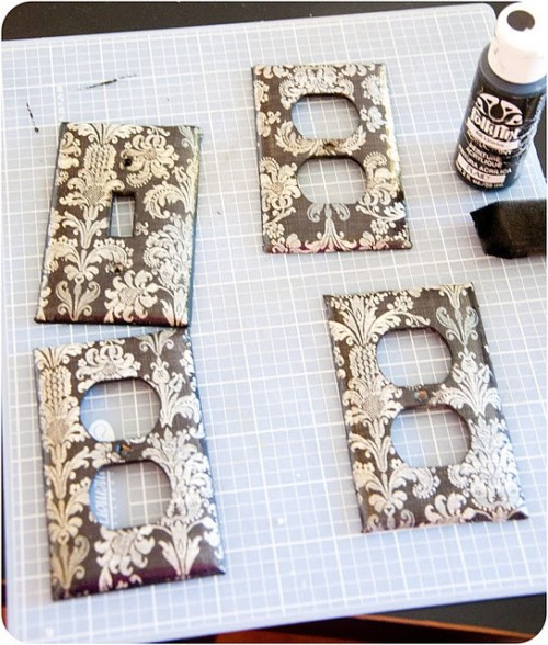 Scrapbook paper on outlet covers and switch plates.