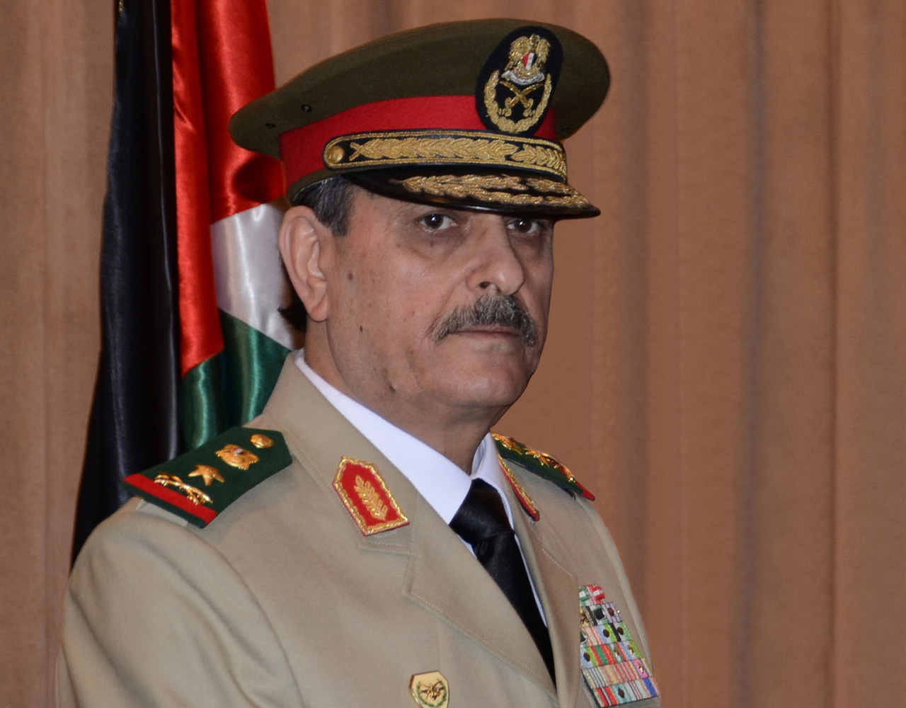 "reuters:  Syria's defense minister and President Bashar al-Assad's brother-in-law were killed in a Damascus suicide bomb attack carried out by a bodyguard on Wednesday, the most serious blow to Assad's high command in the country's 16-month-old rebellion. The bomber, said by a security source to be a bodyguard assigned to Assad's inner circle, struck a meeting attended by ministers and senior security officials as battles raged within sight of the presidential palace. State television said Defence Minister Daoud Rajha and Assad's brother-in-law Assef Shawkat, the deputy defence minister, had been killed in a ""terrorist bombing"" and pledged to wipe out ""criminal gangs"". A Syrian security source confirmed Shawkat, 62, - a pillar of Assad's rule - was killed and said intelligence chief Hisham Bekhtyar was wounded. State television said Interior Minister Mohammad Ibrahim al-Shaar had also been wounded in the blast. READ ON: Bomb kills Syrian ministers at heart of Assad rule"