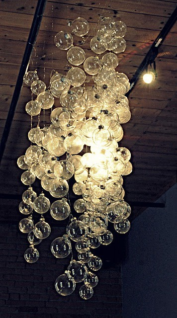 "{DIY ""bubble"" chandelier made from clear Christmas ornaments on string}"
