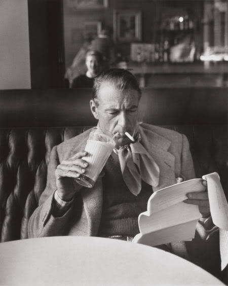 Gary Cooper drinks milk, smokes, and reads.
