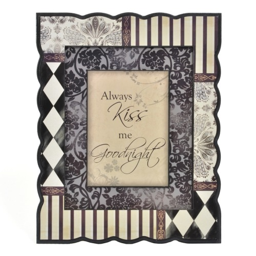 Hang this plaque above your nightstand as a reminder to share the love (kiss, kiss).