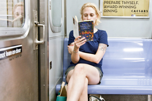 "unypl:  ""By Grand Central Station I Sat Down and Wept,"" by Elizabeth Smart  Read By Grand Central Station I Sat Down and Wept The train was waiting and she was sitting there reading. I saw her through the open doors. I walked in, took a seat infront of her, and I photographed her. She became aware of me after I took the shot. Instinctively, I knew that her awareness was informed. She looked up and asked, ""Are you the underground?"". I hesitated for a moment, as I wondered myself if I was the underground. Then I quickly said yes. She took my hand and held it, so warmly, like we were already connected. I won't forget it. That moment will be a part of me. It will enrich my work. Thank you."