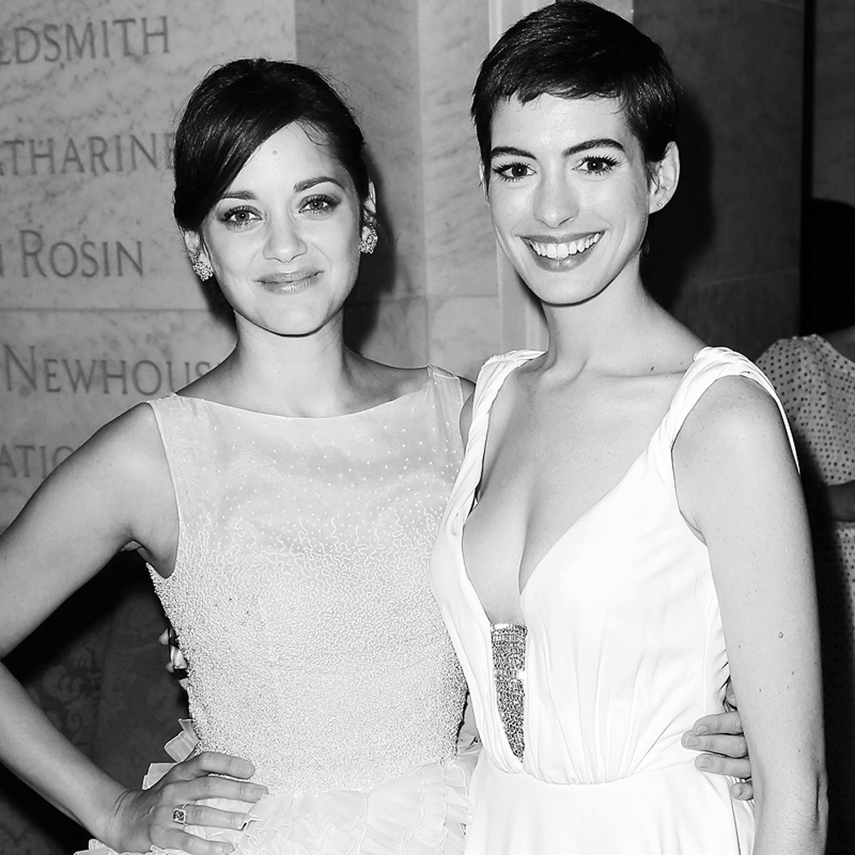 Marion Cotillard and Anne Hathaway at The Dark Knight Rises premiere in New York.See the party photos on Vogue.com