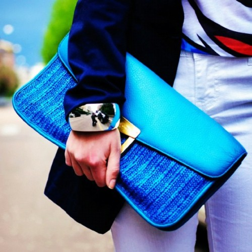 glamour:  A bright clutch is a must!