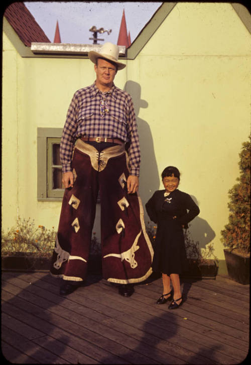Esther Howard with David Ballard White Texas Giant at the World's Fair Flushing, NY., 1940.