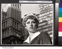 7x7 on Cindy Sherman at SFMOMA:  The opportunity to take in all of [Sherman's Untitled Film Stills] at once is not to be passed up. Splayed across 3 walls, in total they reveal Sherman's one-in-a-million talent for image construction. She knows how much meaning, albeit formulaic, can be transmitted by a particular expression, manner of dress, the way one clutches a carton of eggs. With Film Stills, Sherman lifted the veil from the modern machinery of identity construction, or at least ruffled it, and all with a sense of playful fun.  Read the whole article here.