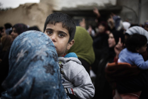 EMERGENCY: The impact of war on Syria's children by unicef: Syria 2012: A boy attends a funeral for a man who was killed, in a town affected by the growing conflict between rebel and government forces. By mid-March, 1.7 million people were affected by the year-long conflict. More than 150,000 have been displaced and 30,000 refugees, half of them children, have fled to neighbouring countries. UNICEF and its partners have requested US$7.4 million to help address the health, education and psychosocial needs of refugee children. © UNICEF/Alessio Romenzi Unicef