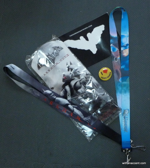 withanaccent:  2012 SDCC Giveaway #3 - DC Universe/Gaming Prize Pack! Your chance to win a compilation of DC Universe/Gaming related items handed out at the 2011 & 2012 San Diego Comic Con! Includes items promoting The Dark Knight Rises, Batman: Arkham City, Green Lantern, and more! And just a note: we don't have a rule that if you win one prize you can't win another - so enter as many of the contests as you like. :D