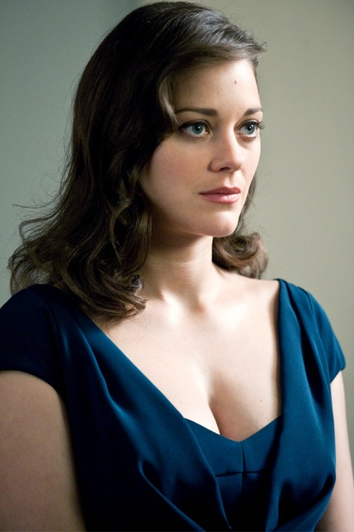 nedhepburn:  Marion Cotillard in The Dark Knight Rises.   Oh, now I know why Tha Kate wanted the front row of the balcony. ;)