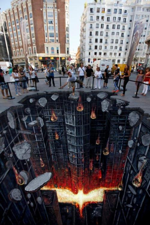 magnolius:  This incredible 3D street art illusion was recently unveiled in Madrid, Spain to promote the release of The Dark Knight Rises which is in theatres this Friday.