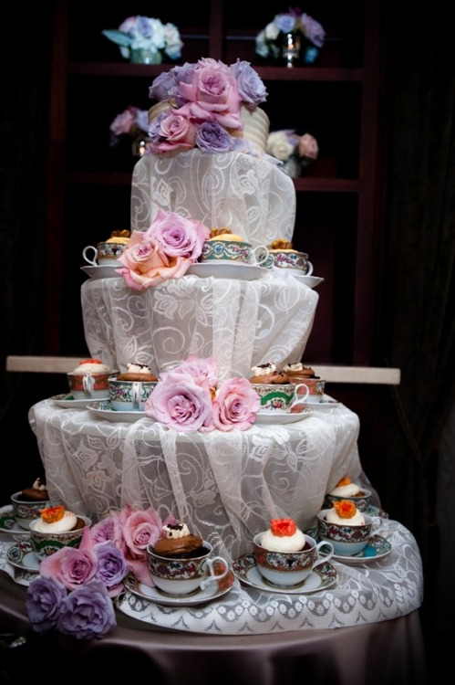 More cupcakes! A small cake for cutting sits atop the risers and how lovely are the literal cups?