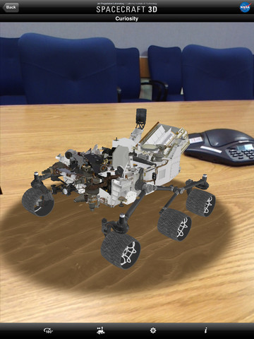 NASA's Augmented reality 'Spacecraft 3D' app available now. The free app lets you use the camera on your iPhone or iPad to show a NASA rover rolling around 'in the real world'. The current range of rovers available includes Curiosity - which is due to land on Mars in just over two weeks. The range of rovers will be expanded with future updates. Check out the app here at the iTunes store.