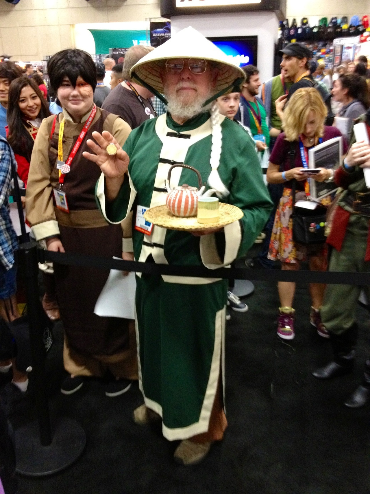 AMAZING UNCLE IROH! That's his daughter as Zuko next to him. She introduced him to the series and talked him into cosplaying. He was really into it though, as anyone willing to carry a tea set around the convention floor has to be.
