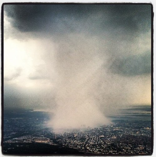 laughingsquid:  Amazing Photo Showing Storm Concentrated on New York City  ?There's a pretty crazy storm taking place right now here in New York City. Former NFL linebacker Dhani Jones shot thisamazing Instagram photo from a Delta flight at 10,000 feet that shows just how concentrated the storm is on NYC as it heads from Queens into Manhattan.""