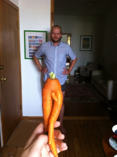 deliciousnachos:  Here's a picture of me holding up the deformed carrot I got in my farm share last week.