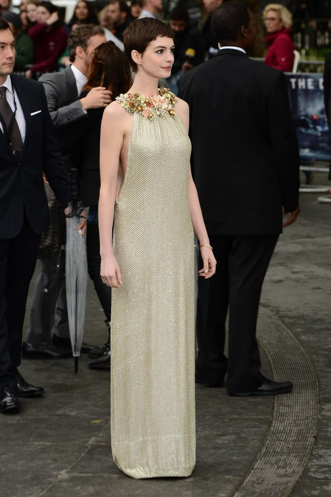 Anne Hathaway (in Gucci) at the London premiere of The Dark Knight Rises, July 18th I love this dress mainly because, even though at first glance it looks demure, it's actually very daring with open sides showing her lovely shape.  This and the embellished neckline that compliments her hair so perfectly make it a perfect look for her.