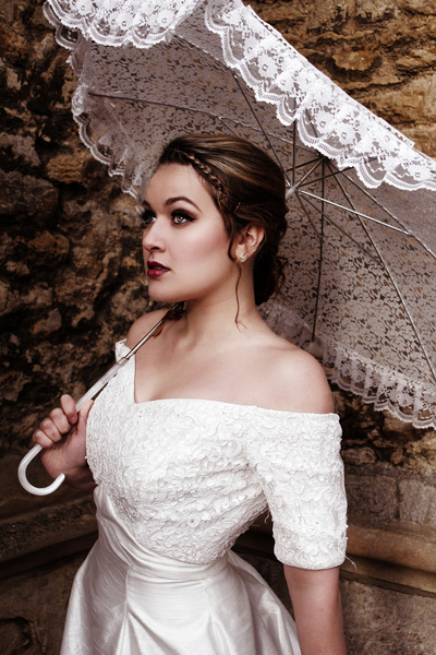 Love the parasol and the delicate braided headband! (via Bridal Photoshoot | Lauren G. | Beautylish)