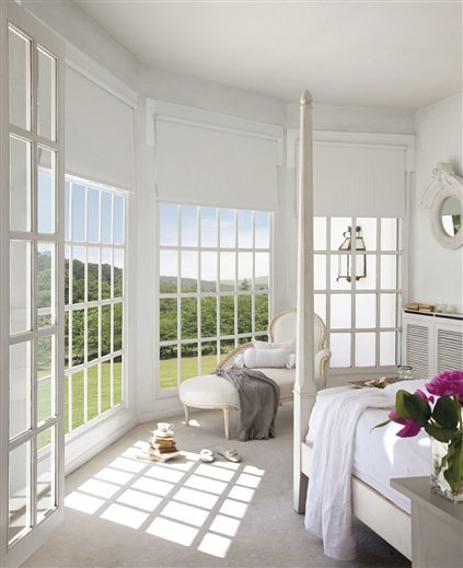 This home is in Madrid. White on white and soft greys, with beautiful French furniture.