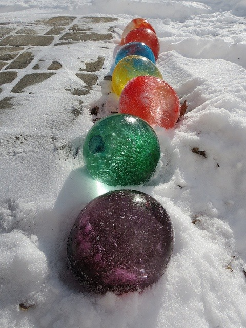 Fill balloons with water and add food coloring, once frozen cut the balloons off and they look like giant marbles.