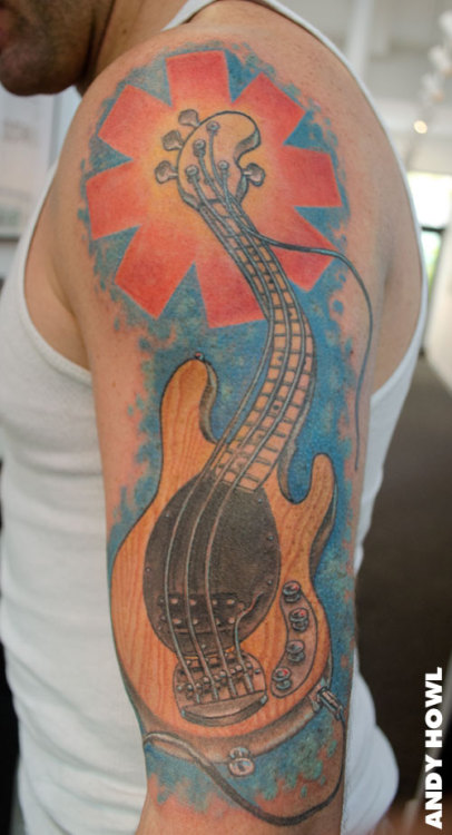 Bass Guitar/Chili Peppers tattoo by Andy HowlHOWL Gallery/Tattoo Fort MyersTumblr: http://www.andyhowl.com