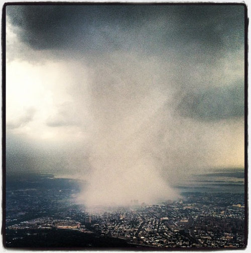 Earlier today, a massive thunderstorm pummeled the NYC home office of SKI BUMS, and an ex-NFL player named Dhani Jones shot this epic Instagram photograph of it from 10,000 feet up on a Delta airlines flight. Incredible!