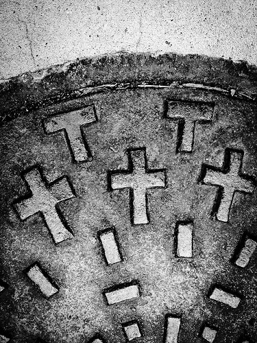 Crosses on a sewer cover, closer.  Flickr: http://flic.kr/p/czExLh