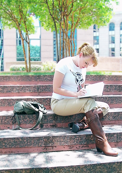 rule63rules:  [Photoset: Three images of a cosplayer dressed as rule 63'd Steve Rogers, wearing a white shirt with an eagle emblem, dog tags, khakis, and tall brown boots. She is shown outdoors in a city, sitting on steps and sketching in a notebook.] midorieyes:  Stephanie Rogers ~ peachesandsushi Part of our fem!Avengers cosplay photoshoot.    So simple, but I love this!! XD