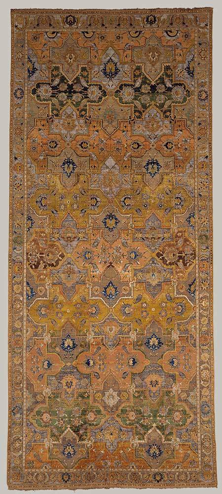 "timur-i-lang:  ""Polonaise"" carpet, 17th c. When, in 1878, a carpet similar to this one was exhibited in Paris, it was assumed that the coats of arms woven into the rug were Polish and that the rug was made in Poland. It was later recognized that this group, distinguished by a silk pile and metallic brocading, was Persian, made during and after the reign of Shah cAbbas I, beginning around the end of the sixteenth or early seventeenth century. The name, however, persisted, and more than 200 examples still bear the name. Many pairs of the type, as here, also survive."