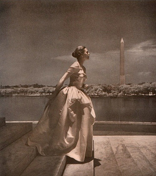 A 1947 Nettie Rosenstein dress photographed by Toni Frissell. I can see the Washington monument in the background, so this is obviously photographed in Washington, DC. Given the view of a lake, monument position and the marble floor, I'd say this was taken at the Jefferson Memorial.