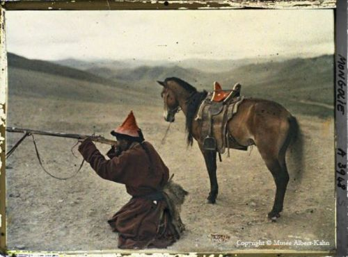 Mongolian nomad hunting with musket, 1913