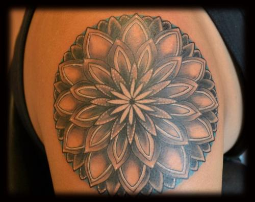 I got my mandala by Scott Kraemer from Fyre Body Arts in Perkasie,PA. I fuckin love it. It's awesome. The teal and white highlights are the best! Thanks Scott!