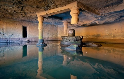 yourmaj3sty:  Kedareshwar Cave - India Local legend holds that when the fourth pillar breaks, the world will come to an end.  The cave of Kedareshwar, in which there is a big Shivling, is totally surrounded by water. The Shivling (also known as Lingam) is a representation of the Hindu deity Shiva used for worship in temples. Whether the lingam symbolizes the physical body of the god or something purely spiritual is the topic of many a century-old debate within Hinduism. The total height from its base is five feet and the water is waist-deep. It is quite difficult to reach the Shivling, as the water is ice-cold. There are sculptures carved out of the rocks here. In monsoon seasons, it is not possible to reach this cave, as a huge stream flows across its path.