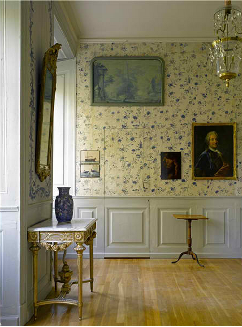 Stola Herrgård, Sweden The Green Drawing Room at Stola Herrgard. Above the soft green dado, the walls are covered in fabric hand painted with trellis leaves.