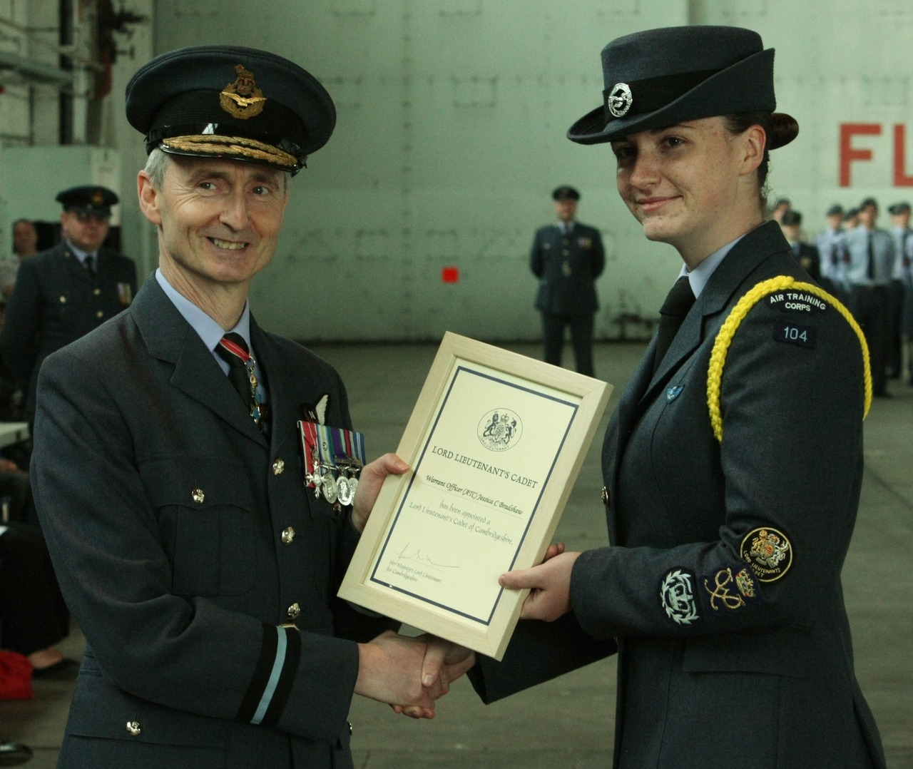 "Honour for Duke of Westminster Air Cadet  An Air Cadet from 104 (City of Cambridge) Squadron has been formally appointed as the Lord Lieutenants Cadet for Cambridgeshire.  Cadet Warrant Officer Jess Bradshaw received the honour from former Commandant Air Cadets, Air Commodore Gordon Moulds during the recent Wing Parade held at RAF Wyton.  The role of Lord-Lieutenant involves presiding at various civic and social events and presenting medals and awards on behalf of The Queen.  As Lord Lieutenants Cadet, Cadet Warrant Officer Bradshaw will attend various functions to assist the Lord Lieutenant as he executes his duty and has already greeted Her Majesty The Queen on her arrival at Burghley House as part of her diamond jubilee tour.  Since joining the Air Cadets Cadet Warrant Officer Bradshaw has gained all three levels of the Duke of Edinburgh's Award, BTEC awards, first aid qualifications, completed the Nijmegan military marches, gained a communicators badge and completed a gliding scholarship plus much more.  Most recently she discovered she had been nominated for the Cambridgeshire Constabulary Young People of the Year awards known as the YOPEYs and is a finalist in the Duke of Westminster award.  With this she is currently  in South Africa for three weeks in July.   Cadet Warrant Officer Jess Bradshaw said   ""To be selected from all the cadets across Cambridgeshire for this prestigious honour is really exciting and one of the highlights of my cadet career.  Representing the Corps, my Squadron and I in this way is a reason to be very proud""  Flight Lieutenant Richard Slack added  ""What Jess has achieved is truly remarkable and serves as good motivation to the younger cadets of what they can achieve if they are motivated and driven."""