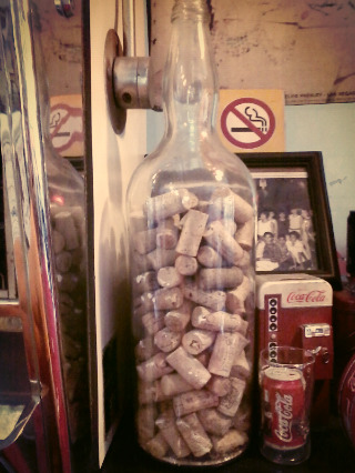 i found this bottle with wine corks from different places around the world…just thought it was cool :))