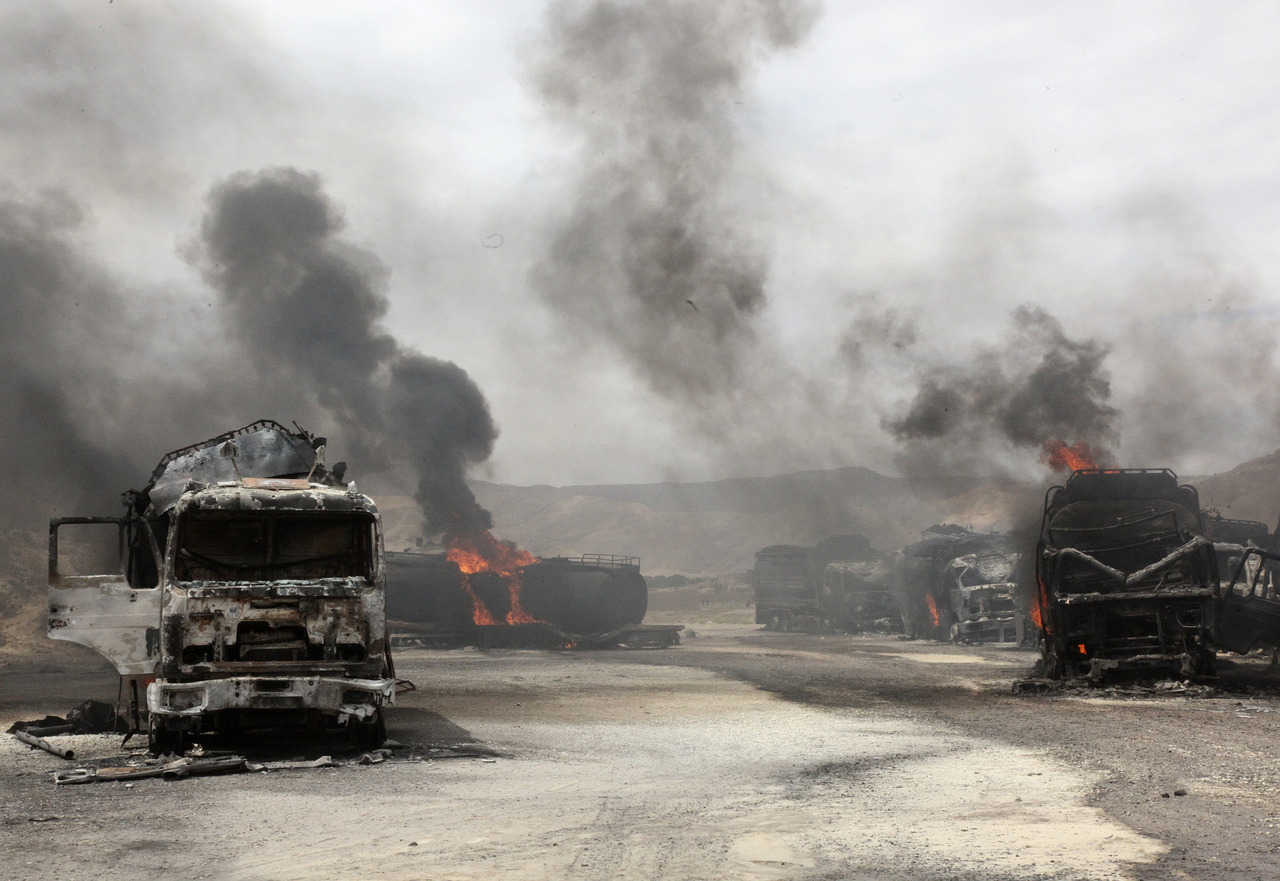 Smoke rises from burning NATO supply trucks in Samangan province, July 18, 2012.  A bomb planted by the Taliban destroyed 22 NATO trucks carrying supplies to their forces in northern Afghanistan, the Taliban and police said on Wednesday. [REUTERS/Stringer] FULL FOCUS: The best Reuters images from the past 24 hours