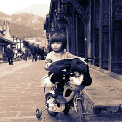 At Luodai Ancient Street, Chengdu, China. Decided to take a candid shot of a girl on her bike. (Taken with Instagram)