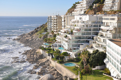 visitheworld:  Apartments at the edge of the Atlantic Ocean in Clifton, South Africa (by RobertCoxwell).