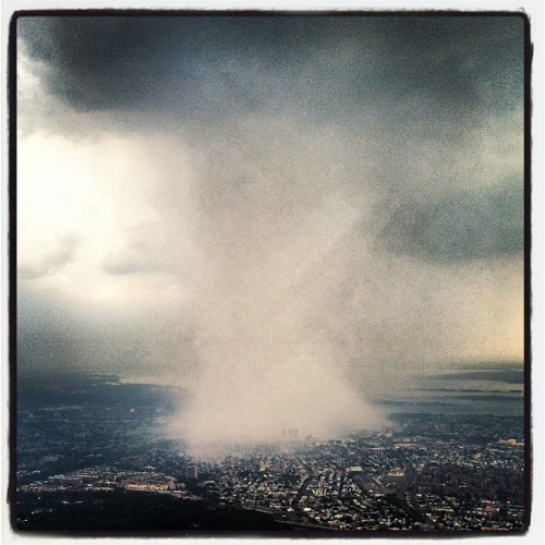 shoesintranslation:  The sudden storm of yesterday swooped over in NYC looks like it was engineered and so localized. Storm tunnel view from an airplane taken with instagram. The storm passes through with a brutal and faint force in the end reminding our city to slow down and take a look up sometimes. Just breath… Ahhhh…