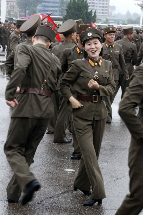 North Korean soldiers dance in the plazas of Pyongyang on Wednesday, July 18, 2012, after North Korea announced that leader Kim Jong Un was granted the title of marshal, a move that cements his status at the top of the authoritarian nation's military as he makes key changes to the 1.2 million-man force.